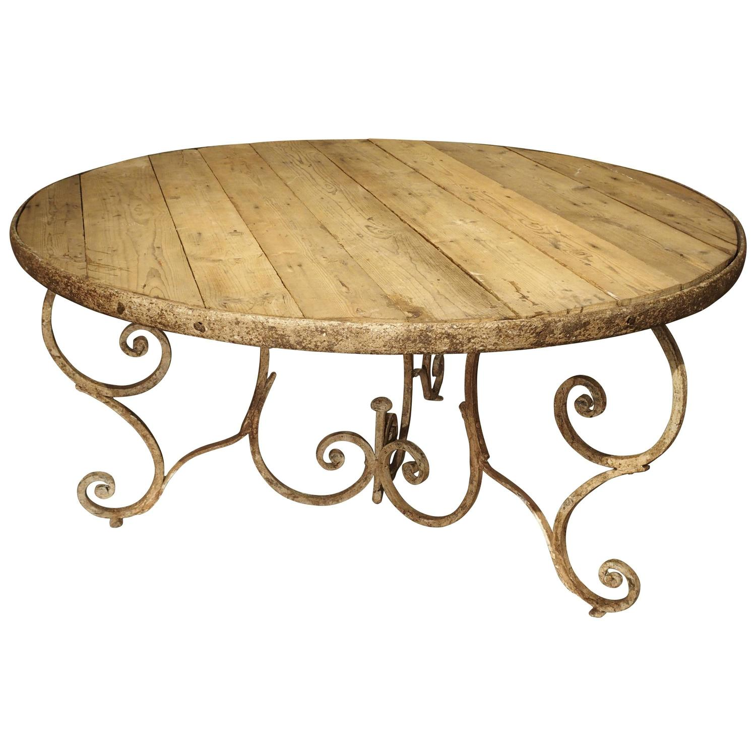 round wooden top dining table with 19th century iron base france for