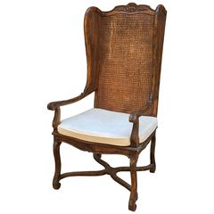 Carved and Caned Wing Chair