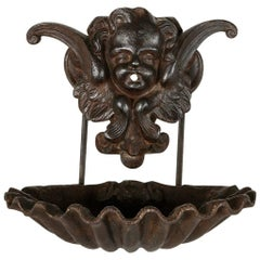 19th Century French Oiled Iron Wall Mounting Water Fountain with Putti and Shell