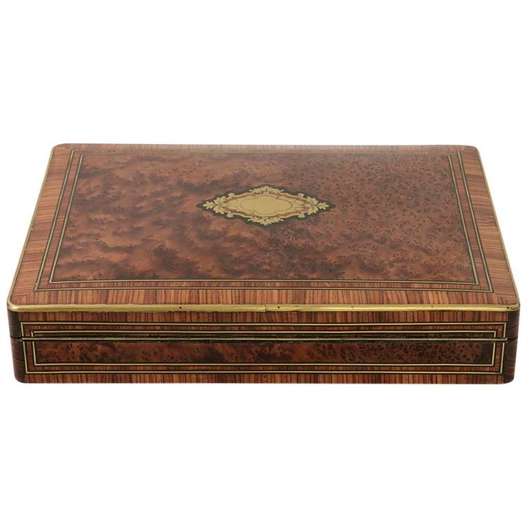 This incredibly rare nineteenth century marquetry game box is made of rosewood, ebony, and plum pudding mahogany with bronze inlay. A rare work from the studio of the renown nineteenth century French cabinet maker, Paul Sormani, the lock is signed