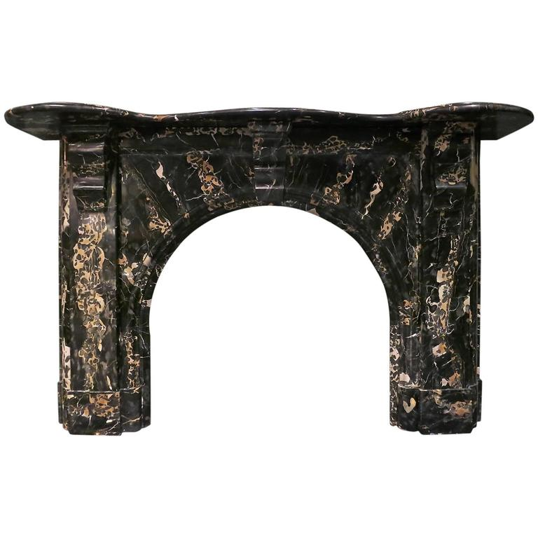 Antique Portoro Marble Arched Irish Fireplace Mantel For Sale