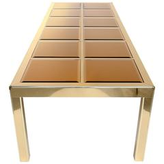 Mastercraft brass extending dining table with mirrored glass panels.