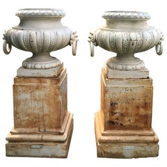 Pair of Rare Estate-Sized Val d'Osne Cast Iron Urns on Tall Plinths