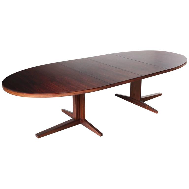 extendable oval dining table in rosewood for sale at 1stdibs. Black Bedroom Furniture Sets. Home Design Ideas