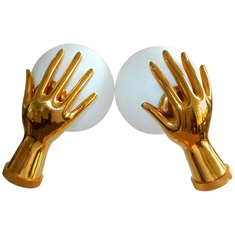 Pair of Arlus Gilt Brass Hands with Opaline Globes Sconces For Sale