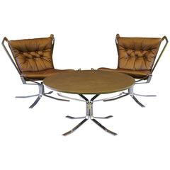 Pair of Leather and Chrome Falcon Chairs and Coffee Table by Sigurd Ressell