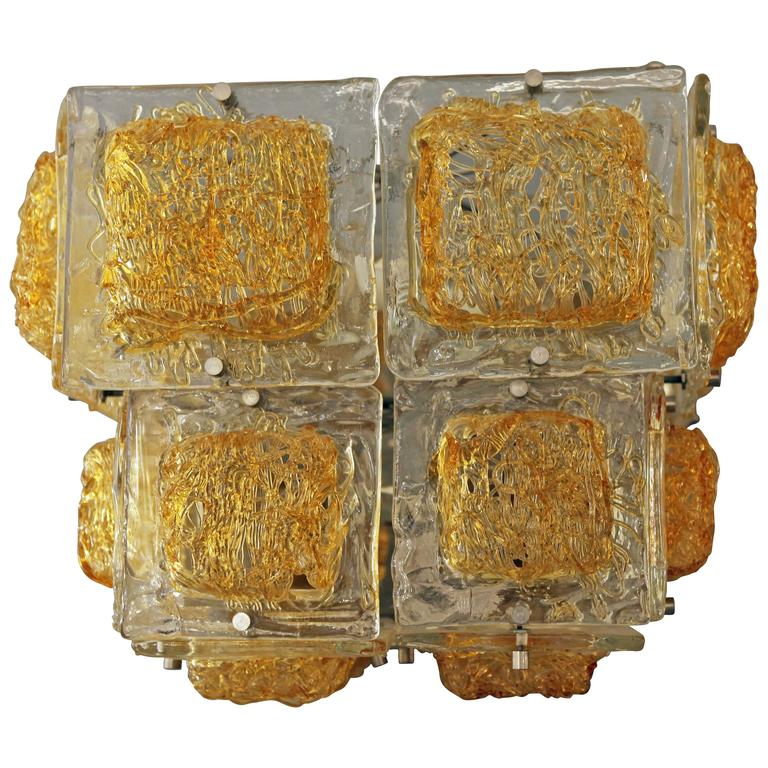A cube Italian chandelier in amber and clear Murano glass 1960