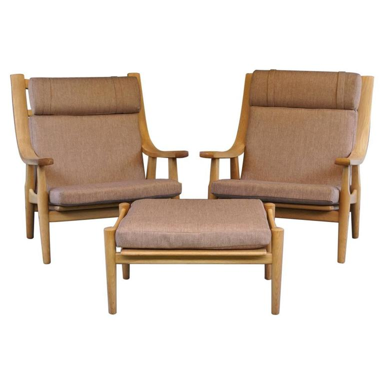 Pair of High Back Oak GE530 Chairs with Ottomans by Hans J. Wegner for GETAMA