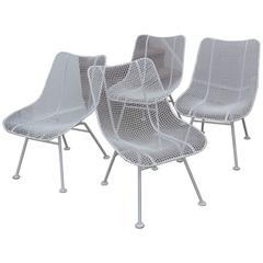 Set of Four 1950s Russell Woodard Iron Mesh Lounge Chairs
