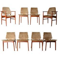 Eight Danish Modern Teak Dining Chairs in the Manner of Arne Hovmand Olsen
