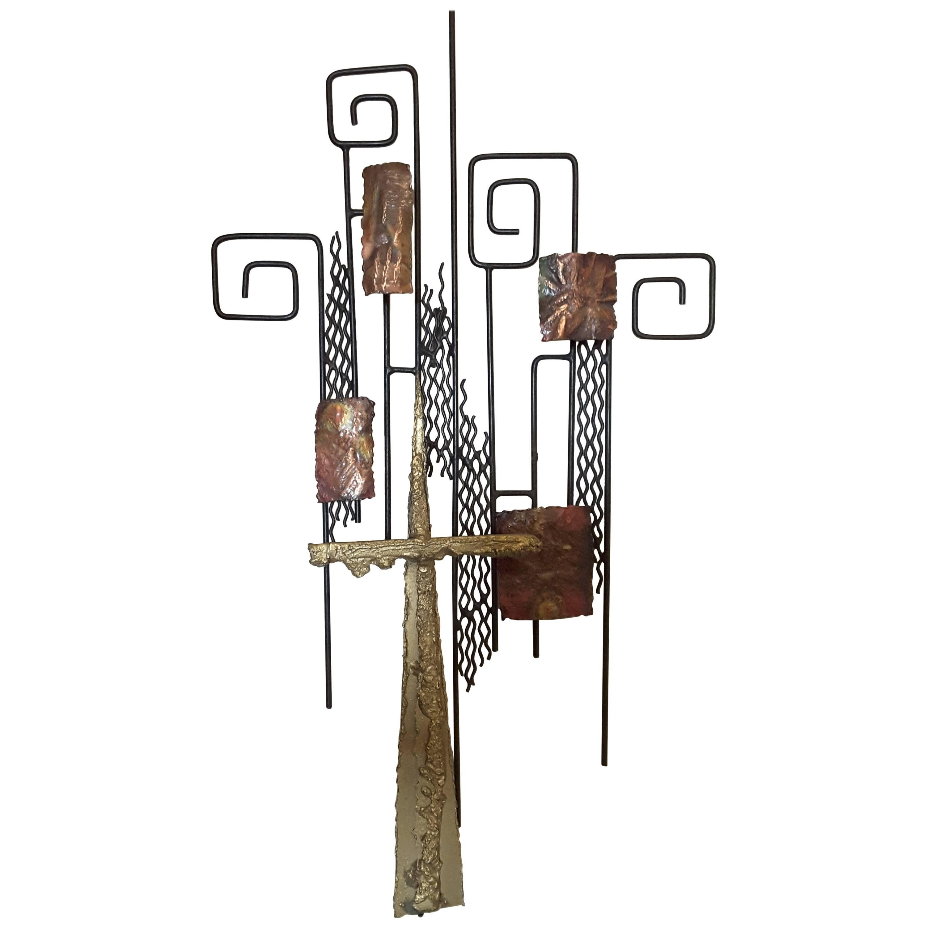 A Mixed Metal Wall Sculpture in the Manner of Curtis Jere