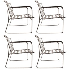 Set of Four Wrought Iron and Plastic Strap Garden Patio Chairs