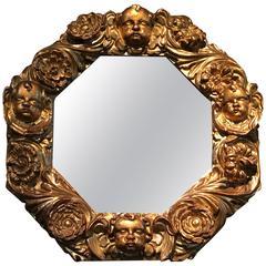 Giltwood Octagonal Mirror with Cherubs Heads, 17th Century