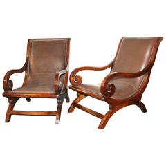 Pair of Early 20th Century Teakwood and Leather Open Armchairs