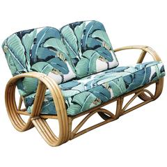 Restored 3/4 Round Pretzel Three-Strand Rattan Loveseat