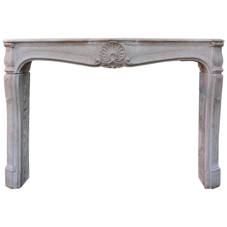 19th Century French Limestone Louis XV Style Fireplace Mantel For Sale