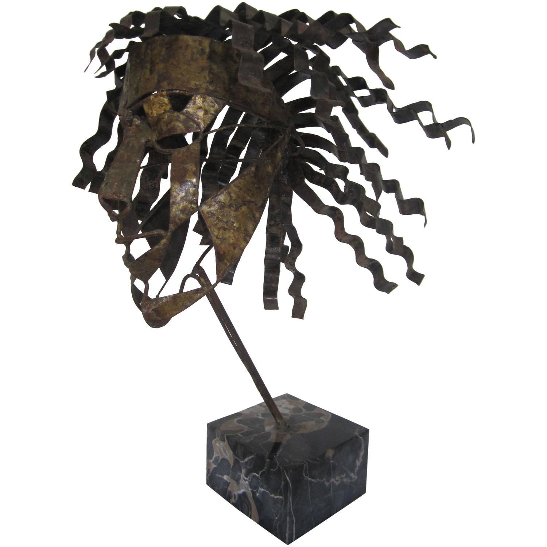 Vintage metal face mask sculpture on black marble base for sale at