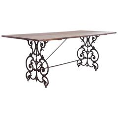 American Wrought Iron and Wood Base Dining Table, circa 1900s