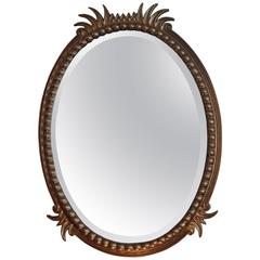 19th Century Hughes Mirror with Oval Golden Frame