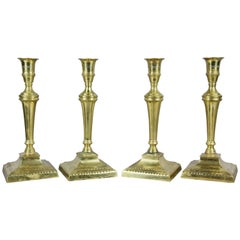 Set of Four George III Brass Candlesticks