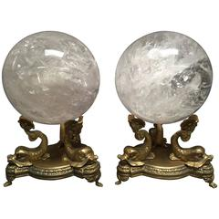 Pair of Neoclassical Rock Crystal Spheres on Bronze Dolphin Bases