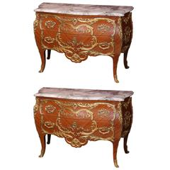 Pair of French Commodes with Marble Tops and Extensive Ormolu Mounts