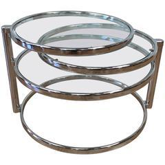 Milo Baughman Style Swiveling Nickel and Glass Coffee Table