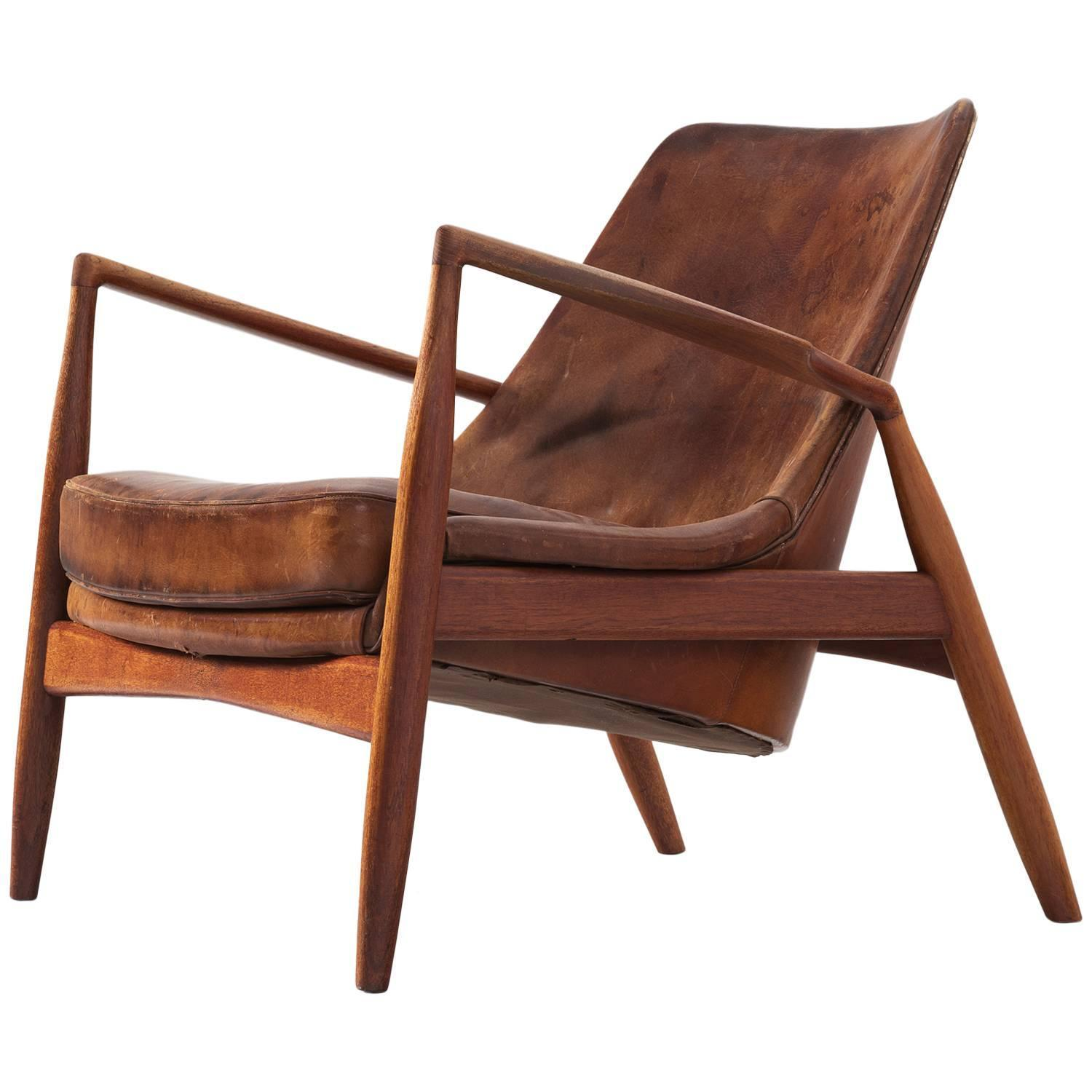 Of four chairs in oak and patinated cognac leather for sale at 1stdibs - Ib Kofod Larsen Seal Lounge Chair In Patinated Cognac Leather For Sale At 1stdibs