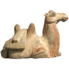 Tang Dynasty Pottery Model of a Recumbent Camel with Removable Saddle