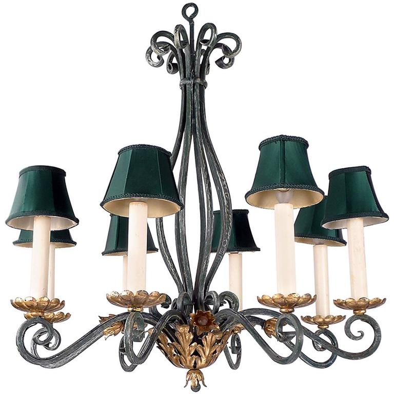 Green Patina Iron Chandelier with Gold Leaf Details For Sale
