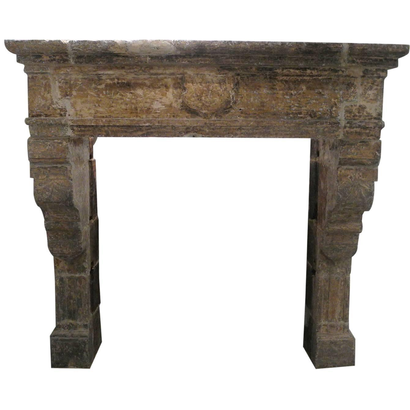 antique renaissance mantel with carved legs and crest atop