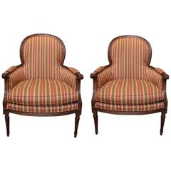 Pair of Carved Walnut Bergere Chairs
