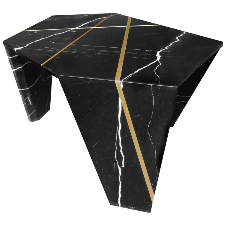 James Devlin Studio's planar cocktail table combines single slab marble with inlaid bronze to create a unique and totally original stone origami sculpture. Each piece begins with a single marble slab cut and hand mitered into customizable geometric