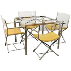 Chrome and Glass Game Dining Table and Four Chrome and Lucite Armchairs