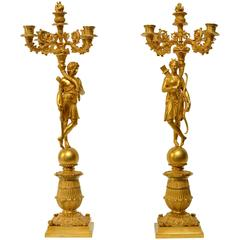 Pair of French Gilt Bronze and Patinated Empire Candelabra, circa 1825