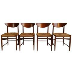 Peter Hvidt & Orla Mølgaard-Nielsen Sculpted Teak and Cord Dining Chairs