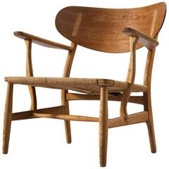 Hans Wegner Early CH22 Lounge Chair in Oak