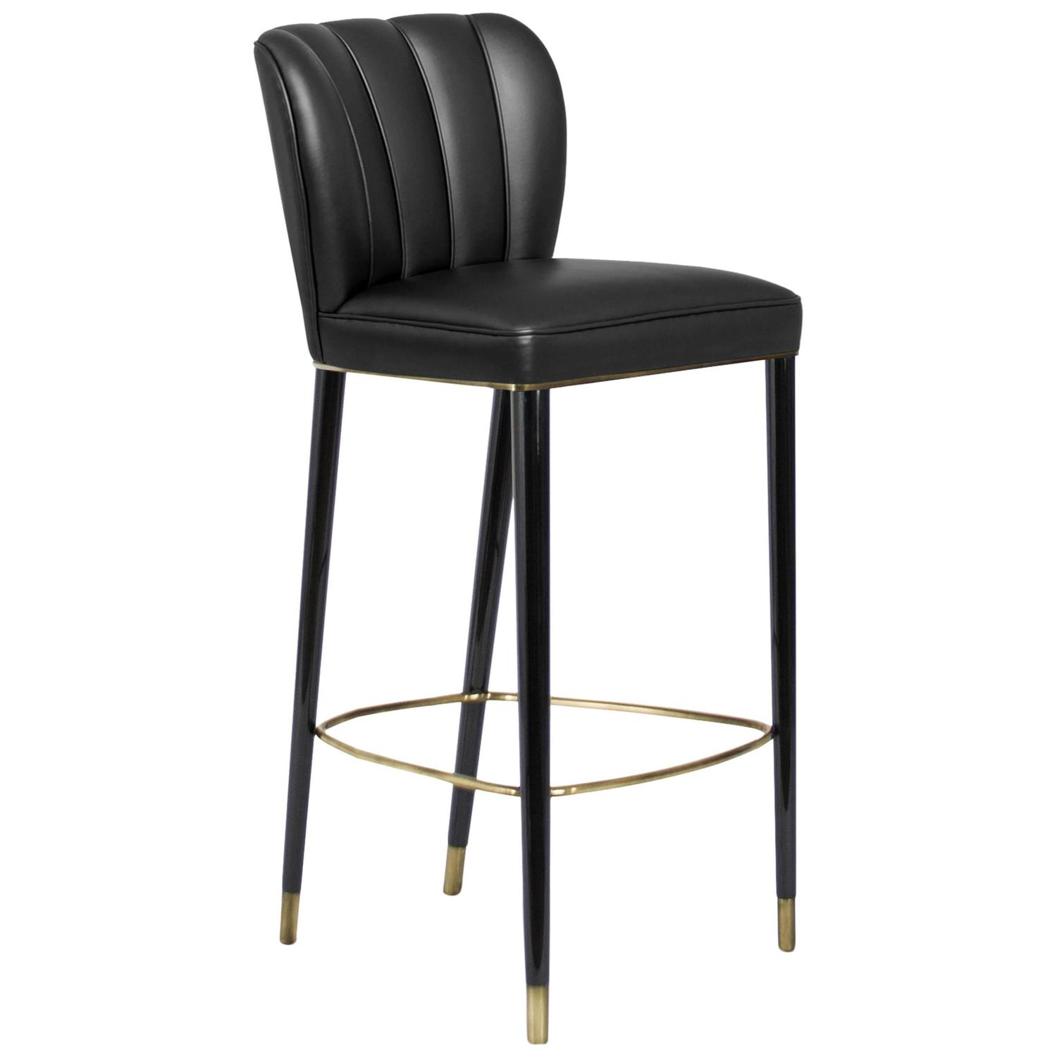dragon bar stool black lacquered with brass details and synthetic leather