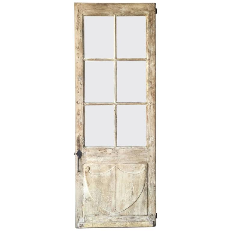 Antique French Walnut Door with Glass and Original Handle and Carved Bottom 1