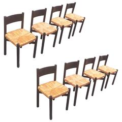 "Charlotte Perriand Exceptional Set of Eight Black Model ""Meribel"" Rush Chairs"