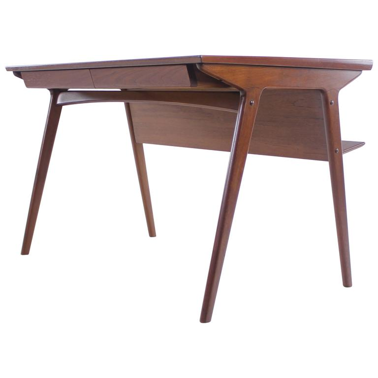 Sleek and stylish danish modern teak desk designed by for Dining table harry styles