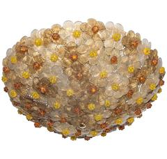 Dome Form Flush Mount Composed of Multiple Amber and Gold Glass Flowers