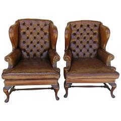 Pair of 1930s English Wing Chairs in Leather