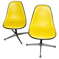 Two Herman Miller Adjustable Swivel Chairs with Naugahyde Covers