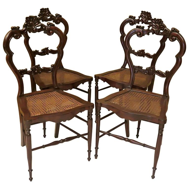 Four 1840 Walnut And Vienna Straw Italian Louis Philippe Chairs