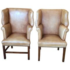 Pair of Petite Distressed Leather Chippendale Style Wing Chairs