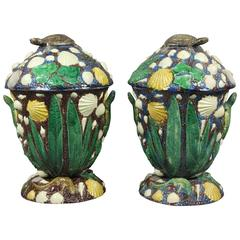 Pair of George Pull Palissy Ware Jars and Covers