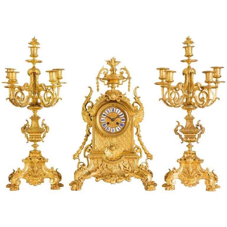 Neo-Gothic antique three piece ormolu clock set