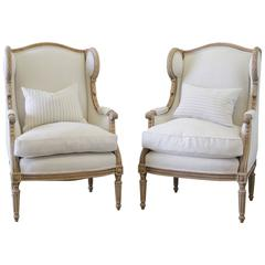 19th Century Louis XVI French Pair of Carved Wing Chairs in Belgian Linen