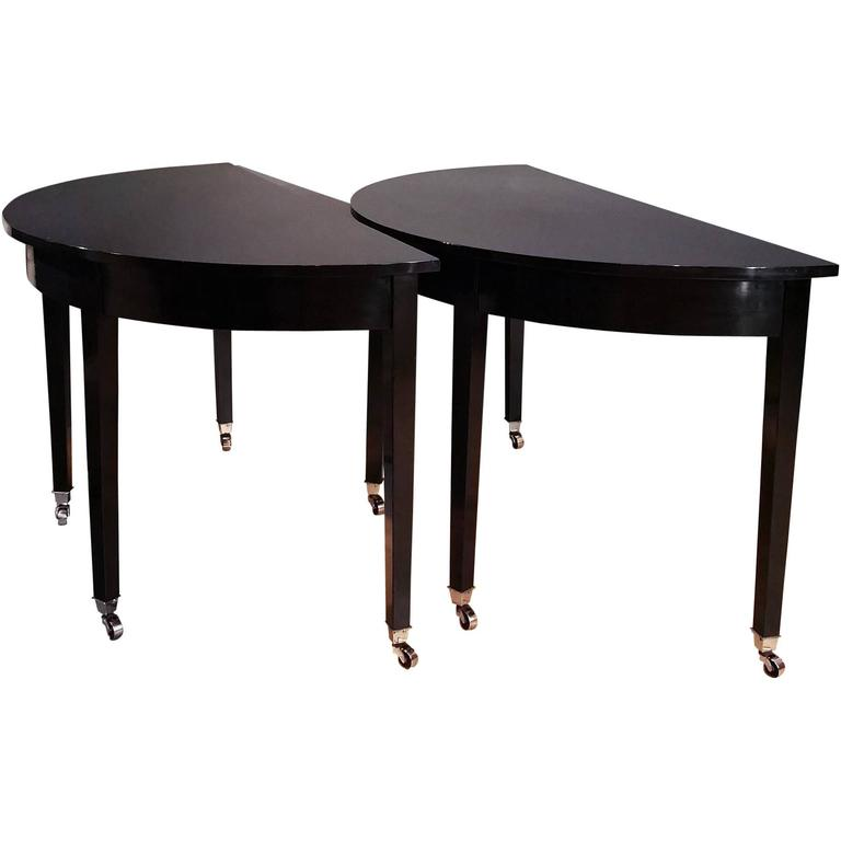 Pair of Early 19th Century Ebonized Mahogany Demilune Console Tables